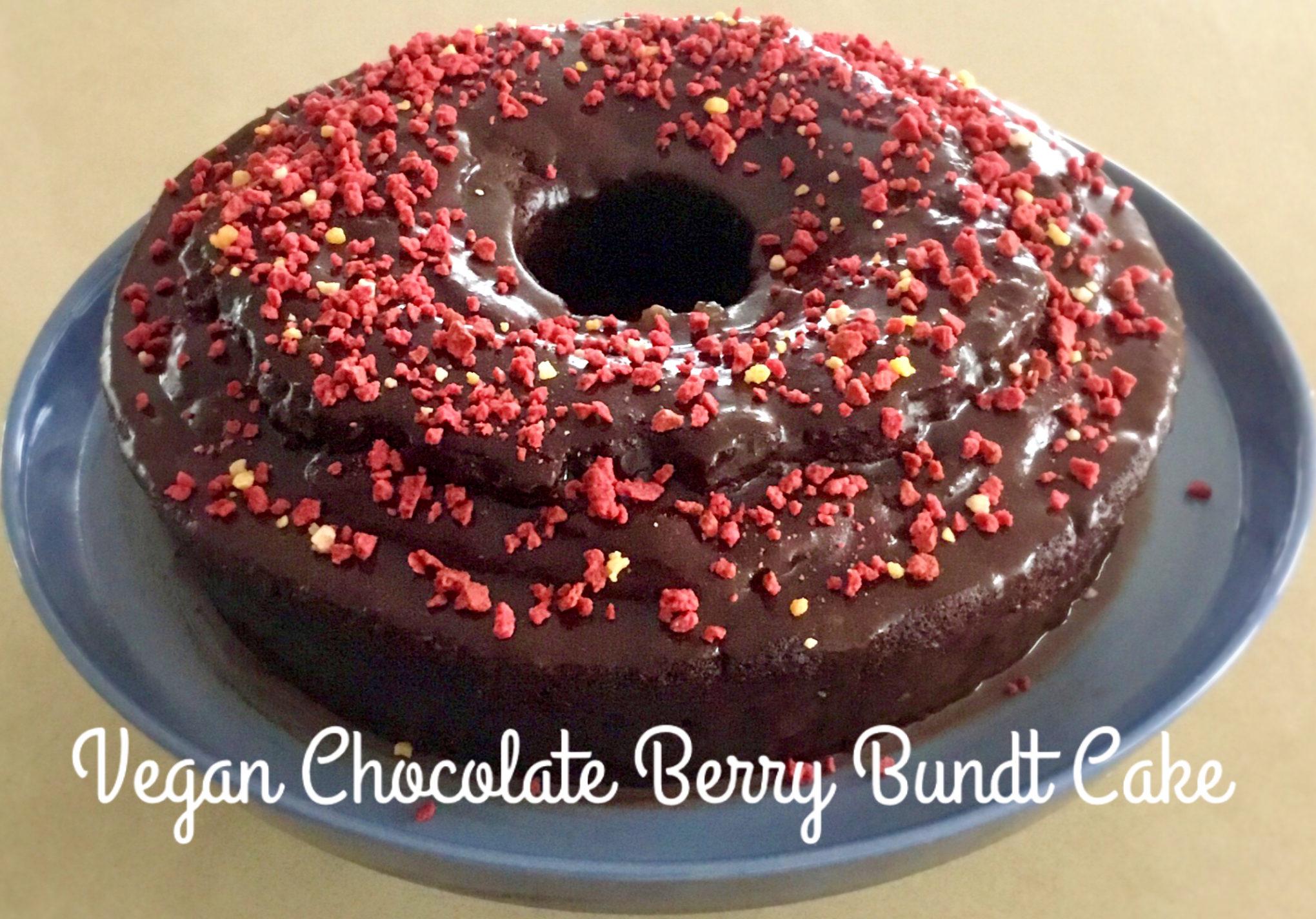 Photo of Vegan chocolate Berry Bundt cake on a blue cake stand