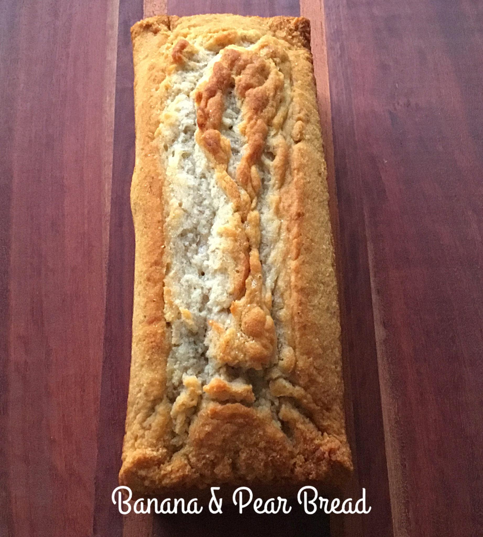 Photo of Banana and Pear Bread - Whole Food Plant Based on a brown cutting board